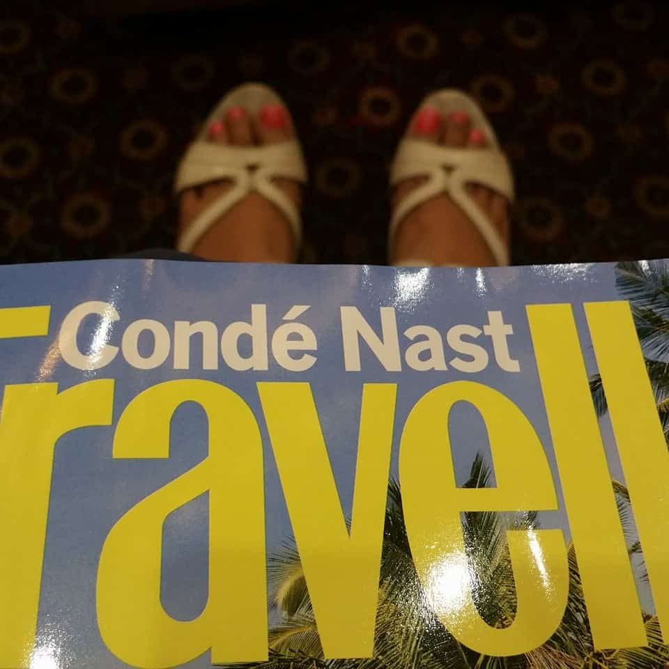 Travel magazine and heels