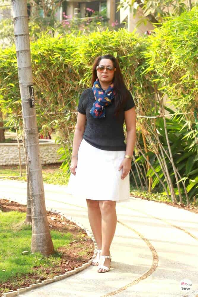 This white A-line skirt is worn with a knitted top and printed scarf. It  will work for a formal Friday casual dressing too. For an extra formal look,  ... 0f0e8b9252